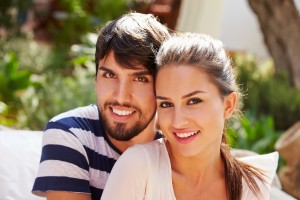 Portrait Of Couple Sitting Outdoors In Garden Together